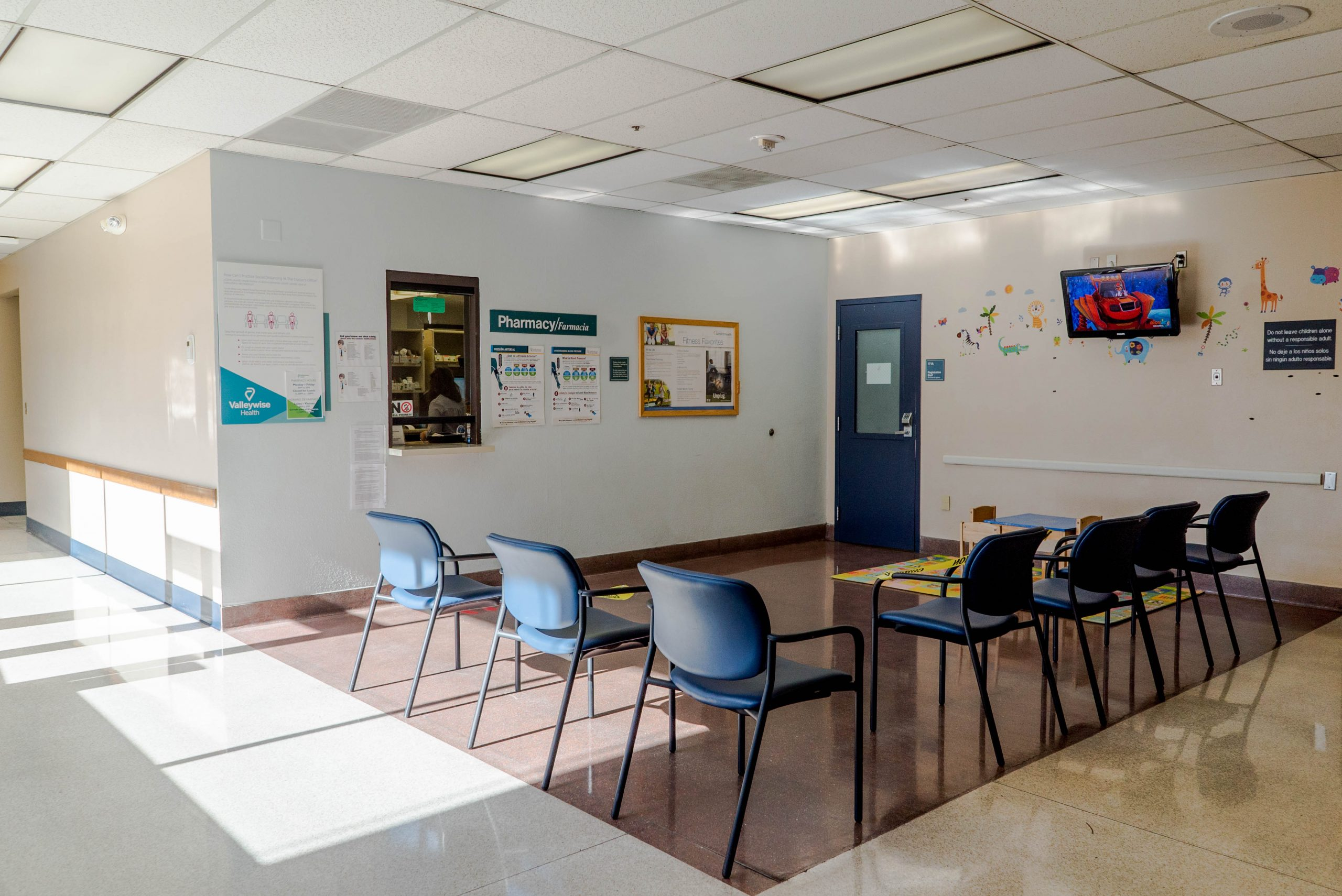 medical center waiting room with blue chairs
