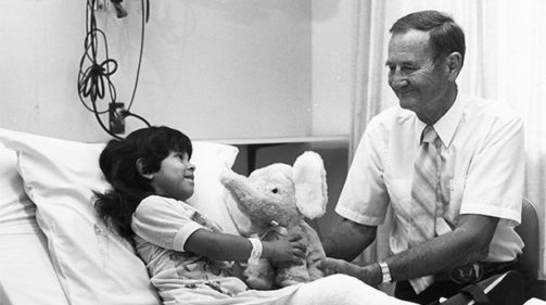 man with young patient in hospital room 1965