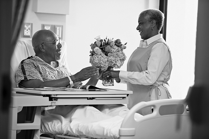 Volunteer bringing patient flowers